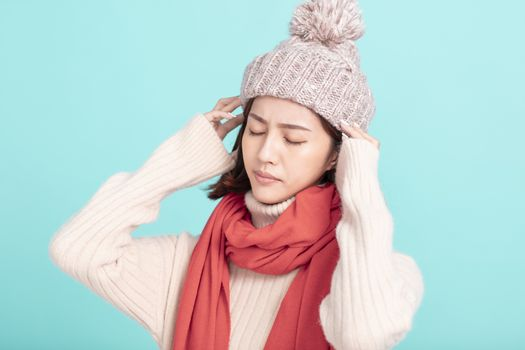 stressed young woman in winter dress with headache