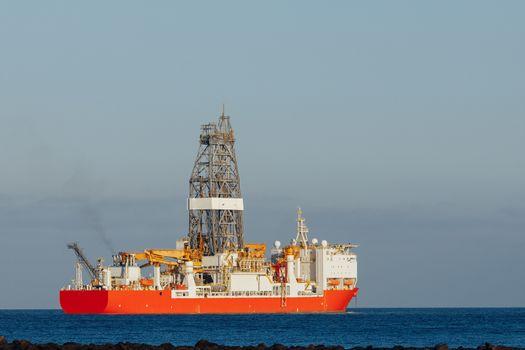 offshore oil and gas drillship, blue ocean background