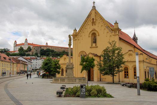 St. Stephan Capuchin Church and Marian column in the old town in Bratislava, Slovakia