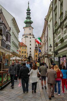Bratislava, Slovakia - July 5th 2020: Bratislava, Slovakia - July 5th 2020: Tourists on Michalska Street with Michael's Gate and Tower in the background, Old Town, Bratislava, Slovakia