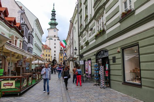 Bratislava, Slovakia - July 5th 2020: Tourists on Michalska Street with Michael's Gate and Tower in the background, Old Town, Bratislava, Slovakia