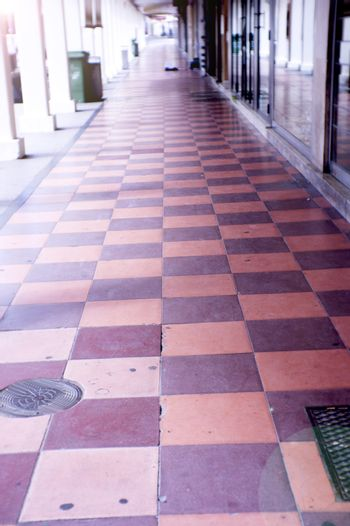 Street flooring in squares of reddish and purple colors