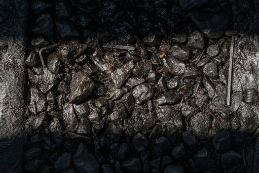 Ballast stone gravel soaked with engine oil in the railroad tracks, Stone background. No focus, specifically.