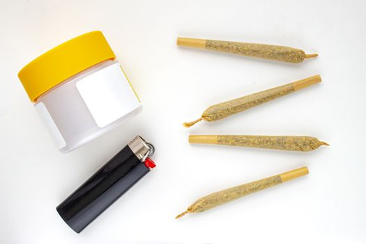 A Cannabis white and yellow plastic packaging container with Cigarettes, Prerolls or Joints and a lighter on a white background