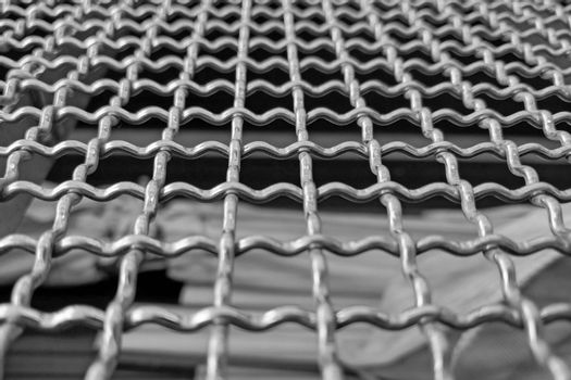 Close-up of a gray metal mesh or railing