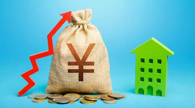 Yen Yuan money bag with red up arrow and residential building. Return on investment. Municipal budget. Recovery and growth in property cost. Increase in prices for apartments and housing.
