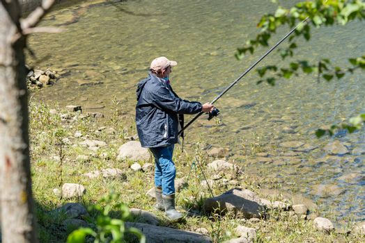 Escaldes Engodany, Andorra : 20 August 2020 : Fisherman in the Engolasters lake  in Escaldes Engordany, Andorra in summer 2020
