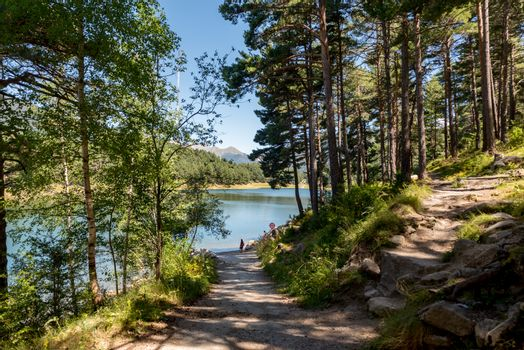 Escaldes Engodany, Andorra : 20 August 2020 : Tourists enjoying the Summer Afternoon at Lake Engolasters in the Pyrenees. Escaldes Engordany, Andorra in summer 2020