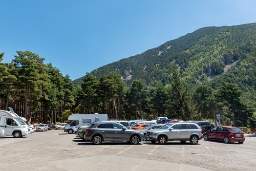 Escaldes Engodany, Andorra : 20 August 2020 : Cars parked in the Engolasters lake parking in Escaldes Engordany, Andorra in summer 2020