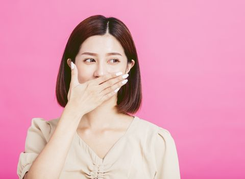 amazed young woman hand cover mouth
