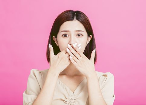 surprised young woman hand cover mouth