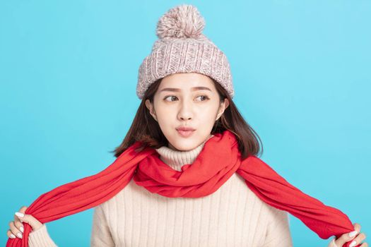 happy young asian woman wearing stylish warm clothes