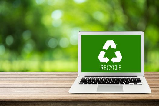 Environment conservation with recycle green icon of labtop on na