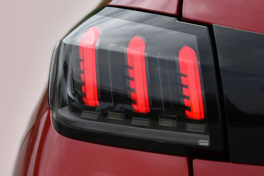 The tail lights on a luxury passenger car