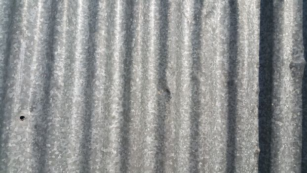 Silver corrugated metal sheet texture background. Steel metal cinc galvanized wave metal sheet for roof and walls.
