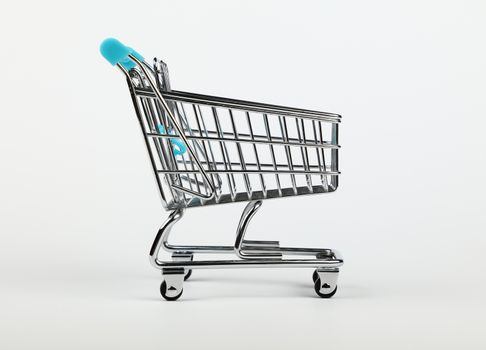 Retail shopping cart over white background