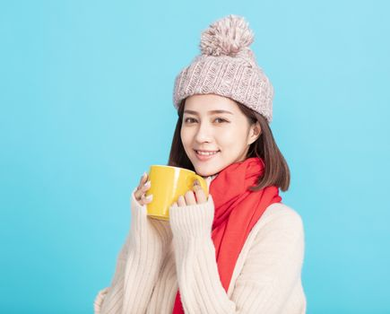 young woman Enjoying a Cup of Hot Tea in Hands