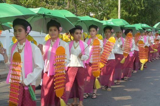 Samut Prakan,Thailand-APRIL 13,2017: Songkran Festival in the Thai-Mon style, featuring a magnificent parade, and see a procession of swan and centipede flags.