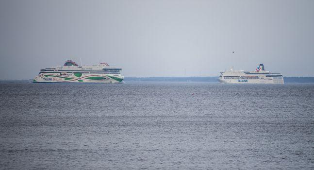 20 April 2019, Tallinn, Estonia. High-speed passenger and car ferrys of the Estonian shipping concern Tallink VICTORIA I and MEGASTAR in the port of Tallinn.