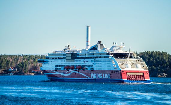 22 April 2019, Stockholm, Sweden. High-speed passenger and car ferry of the Finnish shipping concern Viking Line Viking Grace equipped with rotary sail in Stockholm skerries.