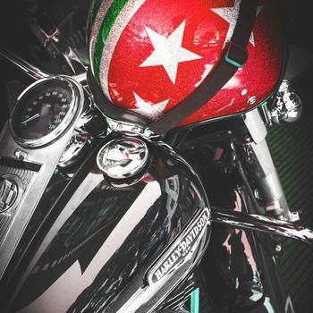 Logo of Harley Davidson motorcycles on a tank and italian helmet. Jesolo (VE), ITALY - July 29, 2017.
