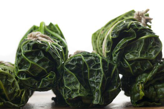 raw cabbage rolls on wood