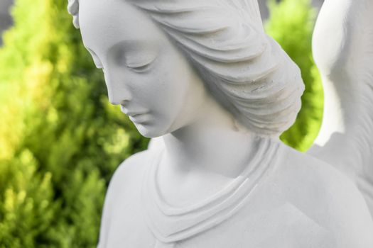 Close up of white stone angel statue