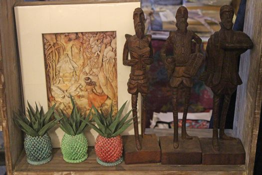 Wood carve figures at First united building in Escolta, Manila,