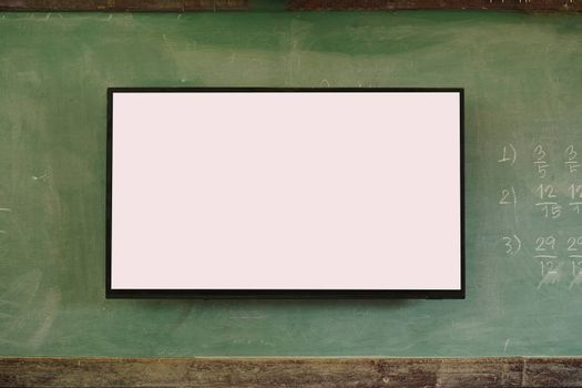 A white display next to a blackboard has a copy area.