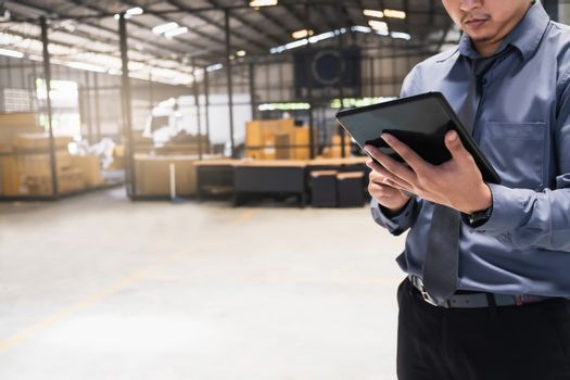 Asian business man writing clipboard on blurred background.metaphor to business in development, success, entrepreneur or employment and advertising logistic image