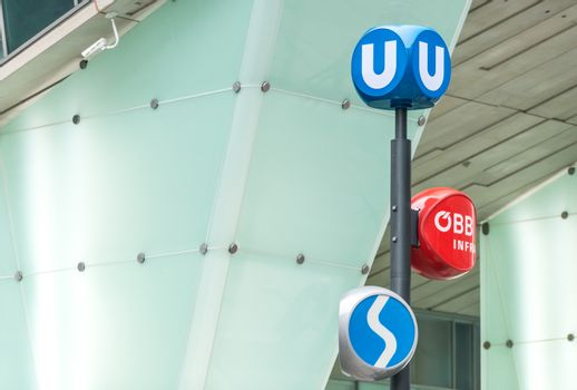 Transportation hub station in Vienna, Austria. Three signs of different public transport systems. Europe travel.