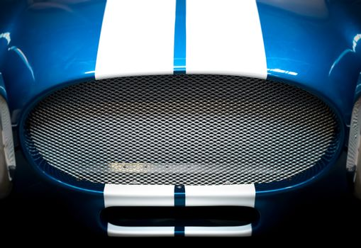Detail of Grille of Blue and White Striped car
