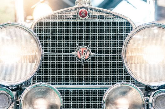 Headlights and grille of a vintage cadillac.