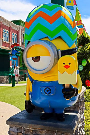 OSAKA, JAPAN - June 17, 2020 : Statue of HAPPY MINION easter version in Universal Studios Japan.Minions are famous character from Despicable Me animation.Universal Studios Japan reopening after COVID-19 quarantine.