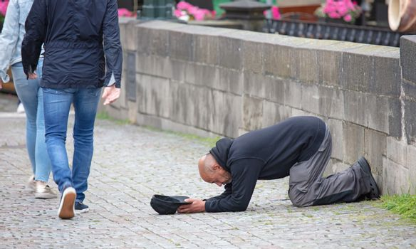 Prague, Czech Republic on july 8, 2020: Beggar begging for alms