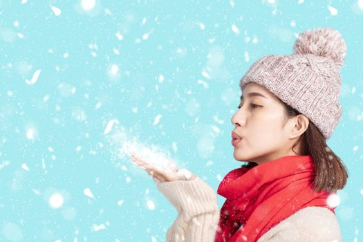 young woman in winter clothes and  Blowing Snow