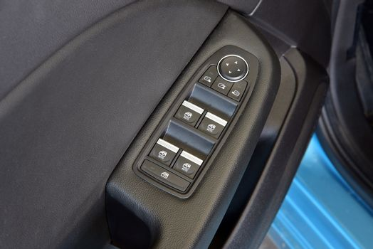 Side mirror switch control and window button