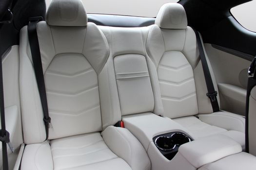 The white rear seat of a luxury sports car