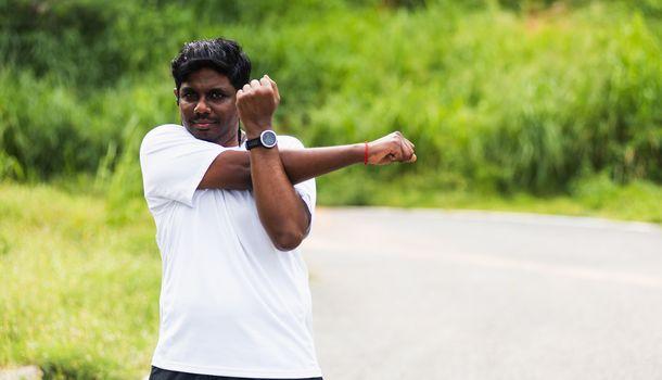 sport runner black man wear watch he body warming up arms muscle