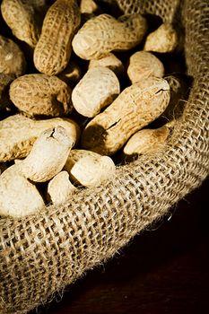Unpeeled peanuts in a bag close up
