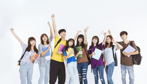 happy young student group standing together
