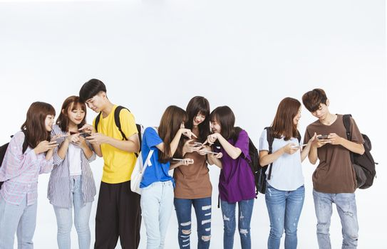 young student group watching the mobile phone and standing together