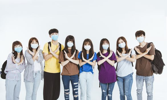 young student group wearing protective medical face masks standing together with NO gesture