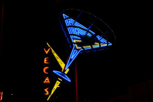 """Las Vegas,NV/USA - Oct 09,2016 : """"Oscar's Neon Martini Glass""""  and Vegas giant neon sign on display above the street near Fremont Street Experience in Las Vegas.The Fremont Street Experience is a pedestrian mall and attraction in downtown Las Vegas."""