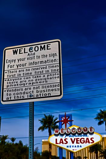 he Welcome to Fabulous Las Vegas sign on bright sunny day in Las Vegas.Welcome to Never Sleep city Las Vegas, Nevada Sign with the heart of Las Vegas scene in the background.