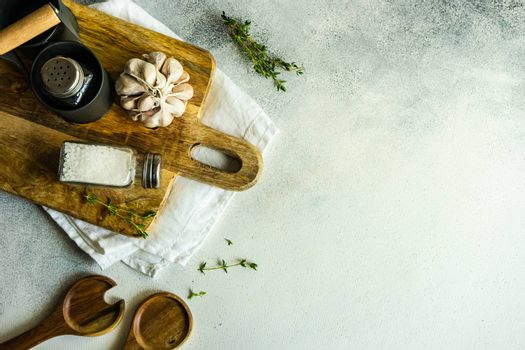 Cooking frame with spices and towel on concrete background with copy space
