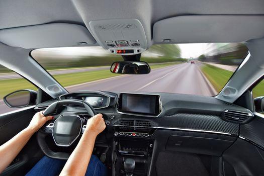 Driving a car. Woman driving a car fast.