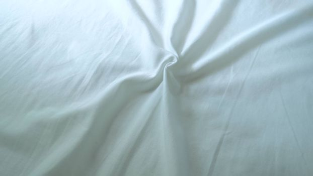 The surface wrinkles of the white bedding in the hotel.