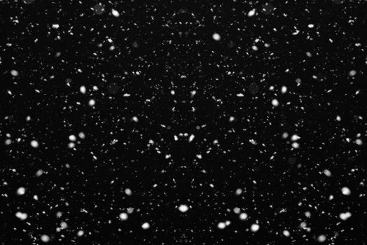 Snow on black background. Falling snow
