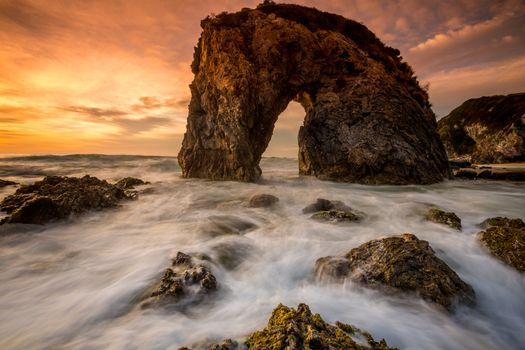 Choppy sea and a magnificent sunrise at Horsehead Rock Australia